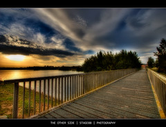 The Other Side (Sam Ili) Tags: bridge light sunset sky sun color art grass clouds canon pond australia canberra hdr act orton lucisart lucis photomatix explored 450d canberrasunset yerrabi goldstaraward canon1022mm3545