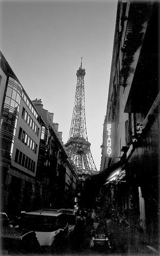 Eiffel Tower looms over the neighborhood, Paris
