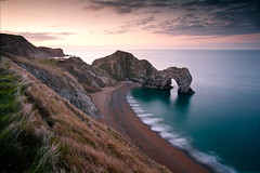 Awaiting the sunrise (Terry Yarrow) Tags: uk sea england sky beach water clouds sunrise canon reflections landscape coast seaside surf tide dorset 1740 shutterspeed lightroom durdledoor jurassiccoast eos5d dorsetcoastpath theunforgettablepictures