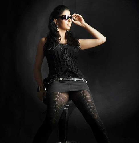 Daisy Bopanna dressed in black tights, black top and black glasses