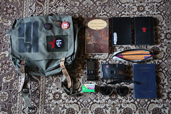 my bag (nuitfunebre) Tags: camera moleskine sunglasses liverpool phone nineinchnails pens mybag tool therion