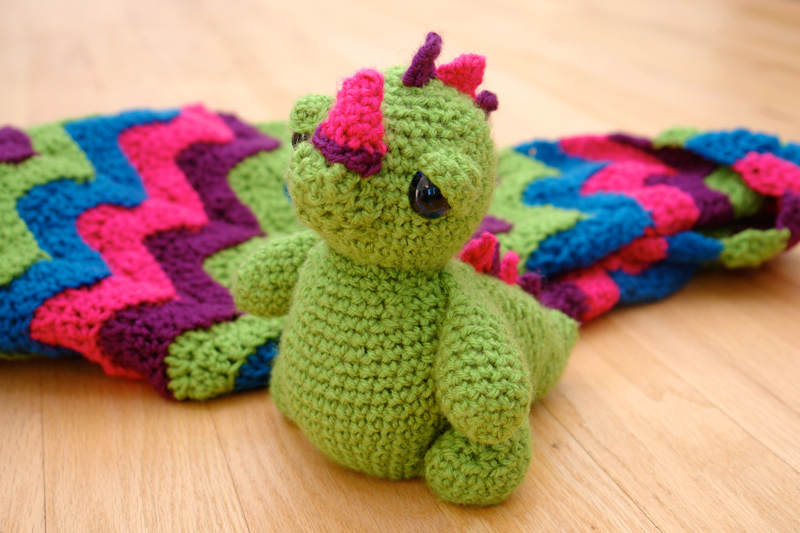 baby dragon with blanket