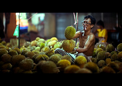 Durian, anyone? (Nasey) Tags: street digital nikon bokeh manatwork working smoking nightmarket malaysia durian nikkor dslr d3 hawker terengganu kingoffruits kualaterengganu 85mmf14d pasarpayang nasey earthasia nasirali csjuly