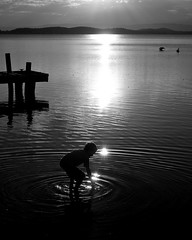 Squids ink black and white II (Jockal) Tags: sunset blackandwhite lake water kids reflections newcastle jetty squidsink panasonicdmctz7