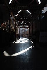 The Old Market (Abdulla H. Al Awadi) Tags: wood old shadow sun nikon dubai textile reflect bazar d80