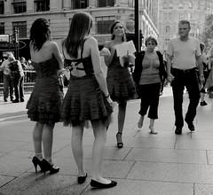 Only Looking (Ian Brumpton) Tags: street uk england urban blackandwhite bw london blancoynegro blackwhite interestingness strada noiretblanc britain pavement candid models streetphotography streetlife streetscene sidewalk londres leicestersquare decisivemoment streettheatre streetphotographer streetfoto singlefingersalute casinogirls
