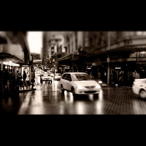 A wet and wild day in downtown #Sydney. #streetphotography #sydneycommunity #iPhoneography #scratchcam @stevoarnold