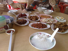 Three bosses having an early New Year's Day Eve lunch of Teochew porridge