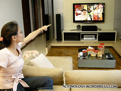 Rachel is more engrossed with Little Nonya on TV than the food