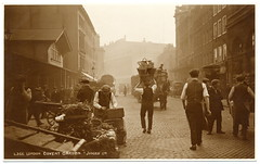 Early in the Morning at Covent Garden (c.1925) (postaletrice) Tags: street old uk inglaterra morning england urban cold flower london history maana westminster fruit sepia vintage garden geotagged early photo calle workers market antique camden postcard united kingdom scene vegetable fresh historic antigua mercado busy covent immersive baskets londres angleterre postal rue march bustle postale carte reino unido matin porters ancienne hustle trabajadores escena tarjeta cestas cpa temprano royaumeuni paniers rppc travailleurs deltiology cartofilia geo:lat=01228 cartophilie geo:lon=515119