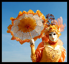 Carnival of colours! (lorytravelforever) Tags: carnival venice sky orange yellow umbrella bravo mask 2009 italians justimagine infinestyle