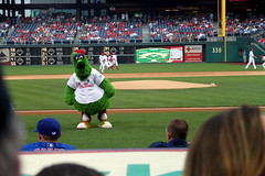 The Phillie Phanatic looking into the visitors' dugout