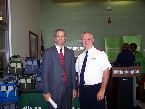 Mike Newbold of Huntington Bank presented Major Richard Amick with 450 backpacks for The Salvation Army.