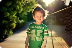 Uncooperative (isayx3) Tags: light portrait sun cute 35mm fence nikon funny dof natural bokeh expression chain explore flare f2 365 nikkor frontpage uncooperative d3 linked plainjoe isayx3 øutstandingimages