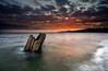 Otter Point Driftwood (Snorri Gunnarsson) Tags: ocean sunset orange seascape green beach yellow flow slow horizon driftwood shutter westcoast otterpoint ndgrad karmapotd karmapotw sheringhampoint gordon´s