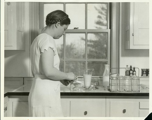 A student ''mother-of-that-week'' living in one of the homemaking apartments prepares the day's food ...