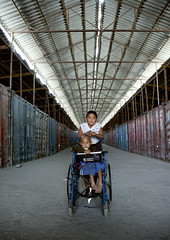 Boy on a wheelchair in the empty Dordoy Bazaar, Bishkek, Kyrgyzstan (Eric Lafforgue) Tags: boy two people male boys childhood vertical youth children person togetherness vanishingpoint kid friend asia sitting friendship market interior wheelchair capital fulllength container together innocence disabled marketplace kyrgyz bazaar handicap centralasia kyrgyzstan twopeople humanbeing bazar containers colorphoto handicape bishkek garcon dordoi capitalcity kyrgyzrepublic kirghizistan lookingatcamera twopersons 9271 dordoy   dordoimarket dordoybazaar   dordoibazaarwholesaleretailmarketbishkek