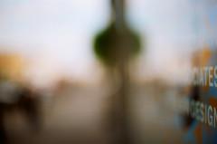 . (Ansel Olson) Tags: street city sky urban abstract reflection film window glass clouds radio studio virginia nikon mood dof kodak bokeh garage atmosphere richmond sidewalk va storefront ambient 100 f3 broad 50mmf14 ektar hangingplant wrir thecamel autaut marvinlangbuilding