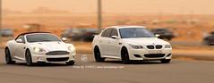 Aston Martin VS BMW M5 (Tareq Abuhajjaj | Photography & Design) Tags: white cars sport race sedan photo high nikon martin top turbo saudi arabia bmw vs sat 1770 panning riyadh m5 v8 aston  v10  v12 ksa  tareq     d700 segma    tareqmoon tareqdesign   5