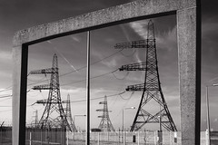 Dungeness - March of the Leviathans (LPOTY 2014) (Sean Hartwell Photography) Tags: england blackandwhite monochrome lines kent power framed lan frame electricity dungeness giants pylons southcoast leviathan nuclearpower 2470mm nationalgrid llens takeaview landscapephotographeroftheyear canon7d