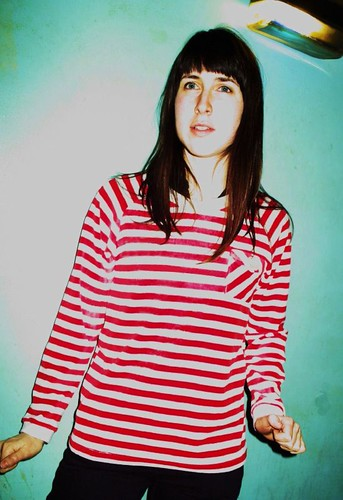 Anna wears QOS Red border sweatshirts!