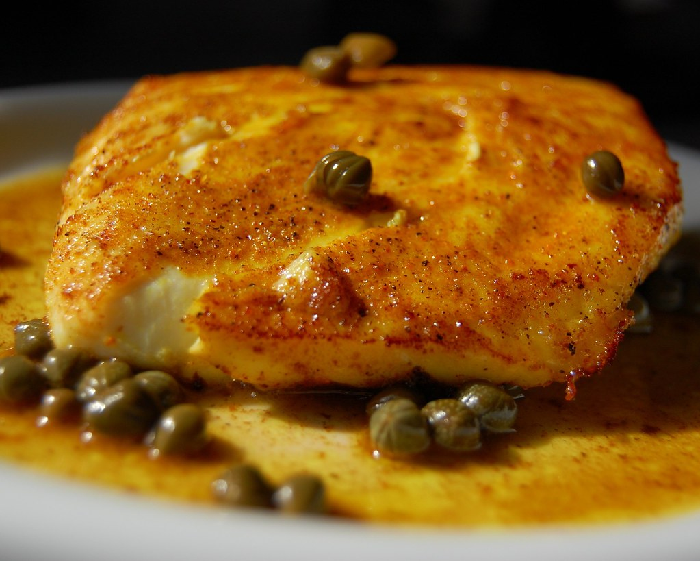 Curry-rubbed Alaska Halibut in a sauce of butter and apple-cider vinegar with capers