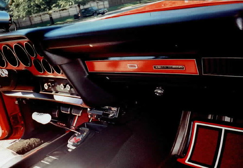 72 Torino with red metal flake steering wheel and dash panels,2001