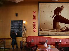 self-portrait with cat (Frizztext) Tags: selfportrait yoga cat restaurant gallery galleries frizzgallery restaurantmurals gosiajanik