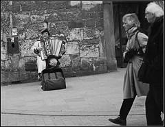 I've told you, don't look at him, just keep on walking down the hill (Jmalls) Tags: krakw powerwalking accordianplayer dontlookathim imstillgoingtolook
