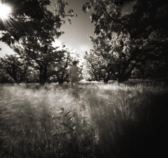 two minutes on infrared: self portrait in the cherry grove (manyfires) Tags: selfportrait film me oregon weeds grove pinhole infrared pacificnorthwest zero2000 cherrytrees zeroimage