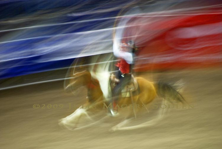 motion blurred cowboy at rodeo