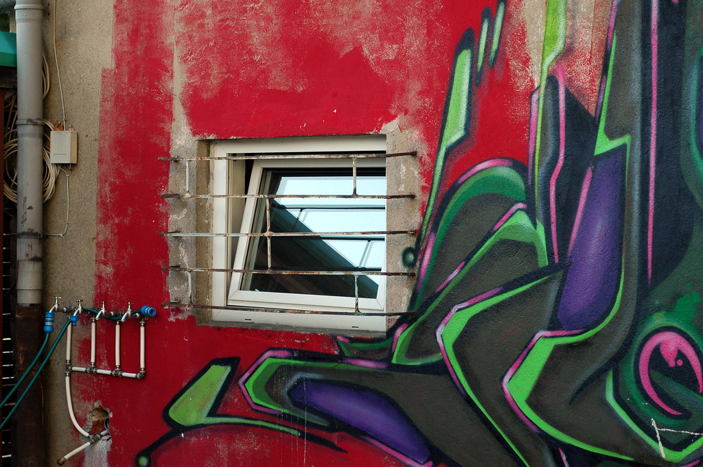Barred window, mural and water taps