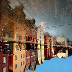 Wet Wharf (aha42   tehaha) Tags: street norway reflections norge picnic upsidedown g gimp unesco squareformat bergen bryggen squarecrop flipped rotated noreg distortions thewharf 500x500 sigma1020 nikond60 overtheexcellence nikoncapturenx2 suggestiontomonica