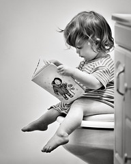 Toddler Reading on Potty by Jay Ryness