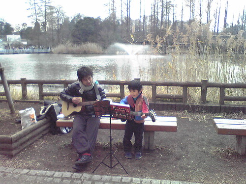Young musician performing Beatles song with his dad at Inokashira Park