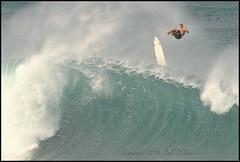 Flying High (Pink Hibiscus) Tags: hawaii nikon surf oahu pipe northshore fullframe fx 2008 pipeline allrightsreserved bigwaves copyrighted banzaipipeline interestingness427 pinkhibiscus d700 monthlythemegroupjan09 explore5april09
