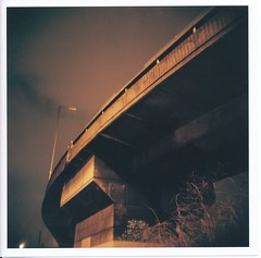 Interzone (Lady Vervaine) Tags: road street city uk longexposure light england sky urban orange london 120 film night speed mediumformat dark amber holga highway glow quiet silent darkness motorway kodak britain toycamera fast overpass silence joydivision glowing 160vc portra guesswherelondon kodakportra160vc westway flyover glowy 120n interzone portra160vc holga120n kodakportra gwl thewestway