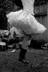 floofy skirt series #6 (lydiafairy) Tags: blackandwhite bw woman selfportrait silly cute me girl fun jump backyard nikon legs boots dressup skirt sit slip wellies playful rubberboots petticoat d80 18135mm floofyskirt