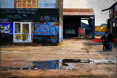 Colourful ruins (Che-burashka) Tags: uk england urban london abandoned architecture creek reflections river puddle graffiti couple closed industrial britain greenwich surreal colourful vanishing deptford warehouses textured laban eastlondon unused builings shotthroughfence otherlondon