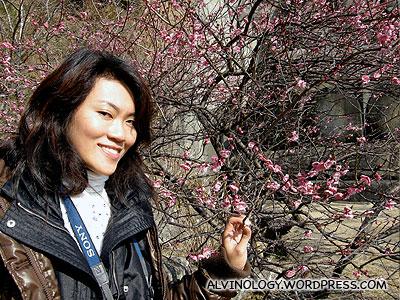 Rachel beside a sakura tree