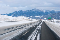 64 (P.YURKOVICH) Tags: road winter mountain snow mountains landscape highway montana driving overcast roadtrip windshield roadside icy winterlandscape icyroad winterdriving winterroads snowroads