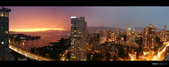 Dream Views (Steve Rosset) Tags: ocean street new city bridge pink light sunset sea sky urban panorama orange seascape canada storm mountains west tower skyline vancouver canon geotagged boats lights amazing cosmopolitan downtown cityscape waterfront view apartment skyscrapers purple traffic pacific fireworks vibrant pano dream trails dramatic columbia tagged celebration condo age highrise end penthouse inlet metropolis glowing british burrard lightning vistas rebirth drama geo luxury hsbc metropolitan 1740mm condominium dreamscape dense 30d vancovuer canonef1740mmf40l steverosset steverossetphotography