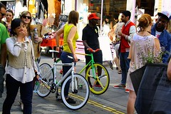 The colourful all 'appenings of Brick Lane! (st.hanshaugenkru) Tags: flowers friends london smiling warm market sunday atmosphere streetlife loveit bicycles colourful chatting bookshop bricklane flowermarket customers leathershop columbiaroad parvez