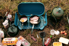 race day breakfast (George Pollard) Tags: morning camping food cooking kitchen grass breakfast bacon d70 tea sunday margarine spoon downhill grill gas lincolnshire kettle stove mug eggs hotsauce challenge spatula pans raceday friedeggs happyeggs belchford cookingongas 130909 thebluestove