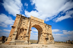 Morocco-090604-290 (Kelly Cheng) Tags: africa travel colour horizontal architecture design daylight ruins arch cloudy outdoor culture vivid sunny bluesky nopeople unesco morocco triumphalarch copyspace volubilis pickbykc