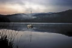 Loch Ard (Stuart Stevenson) Tags: mountains reflection sunrise reeds scotland boat canon300d scottish loch reflexions trossachs hdr lochard kinlochard stuartstevenson canoneos28135mmf3556isusm stuartstevenson