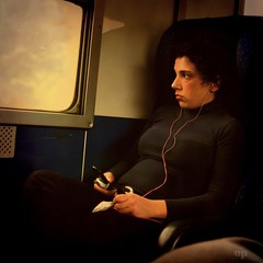 Relieve the Boredom (Osvaldo_Zoom) Tags: light portrait woman girl train bravo boredom commuter