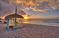 beached (richietown) Tags: topf25 topv111 clouds sunrise canon mexico hotel sand topf50 topv555 topv333 topv1111 horizon topv999 topv777 rivieramaya hdr palapas 30d sigma1020mm 3xp photomatix 3exp richietown alcielo addtoimagekind