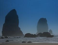 Cannon Beach Oregon (PamINSeattle) Tags: blue mist seascape birds fog oregon sand flickr surf waves award cliffs pacificocean cannonbeach haystackrock seastacks pristine cubism mywinners platinumphoto platinumheartaward fbdg rubyphotographer flickrclassique pamelagerber