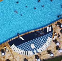 KAP of a hotel pool in Beberibe, CE, Brazil - 02 (Ric e Ette) Tags: blue summer brazil vacation people white holiday water pool gua branco azul brasil umbrella hotel chair pessoas exercise chairs cyan frias piscina sunbath sunshade parasol cear vero kap exercises cadeiras sunbathing sunbathers kiteaerialphotography feriado ce cadeira ciano  coliseumhotel beberibe guardasol sombrinha exerccios exerccio bronzeado  guardasis interestingness125 banhodesol bronzeando bronzeamento fotografiaareacompipa 9mp  hotelcoliseum gettyimagesbrasil
